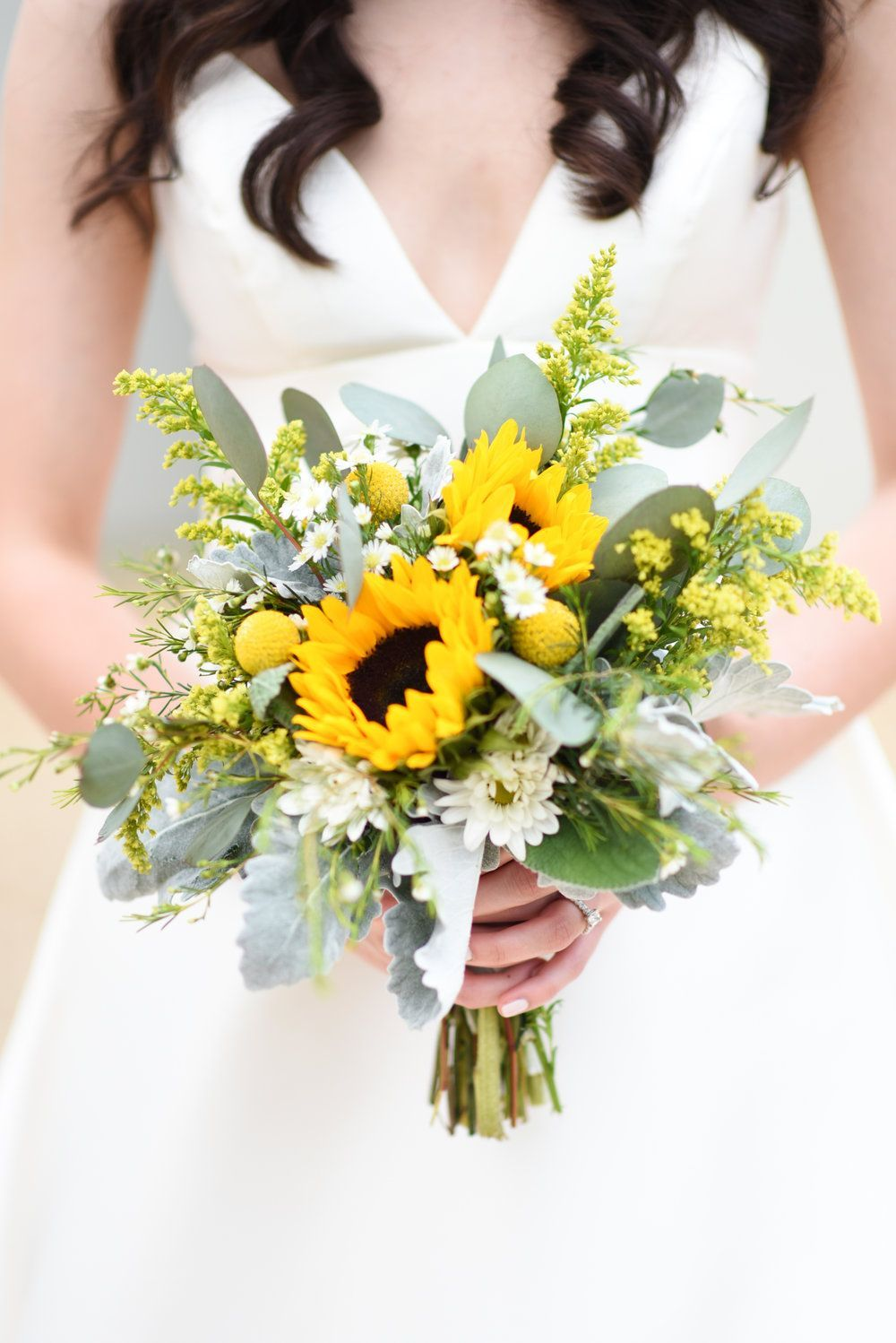 Bright pops of sunflowers in this beautiful summer bouquet