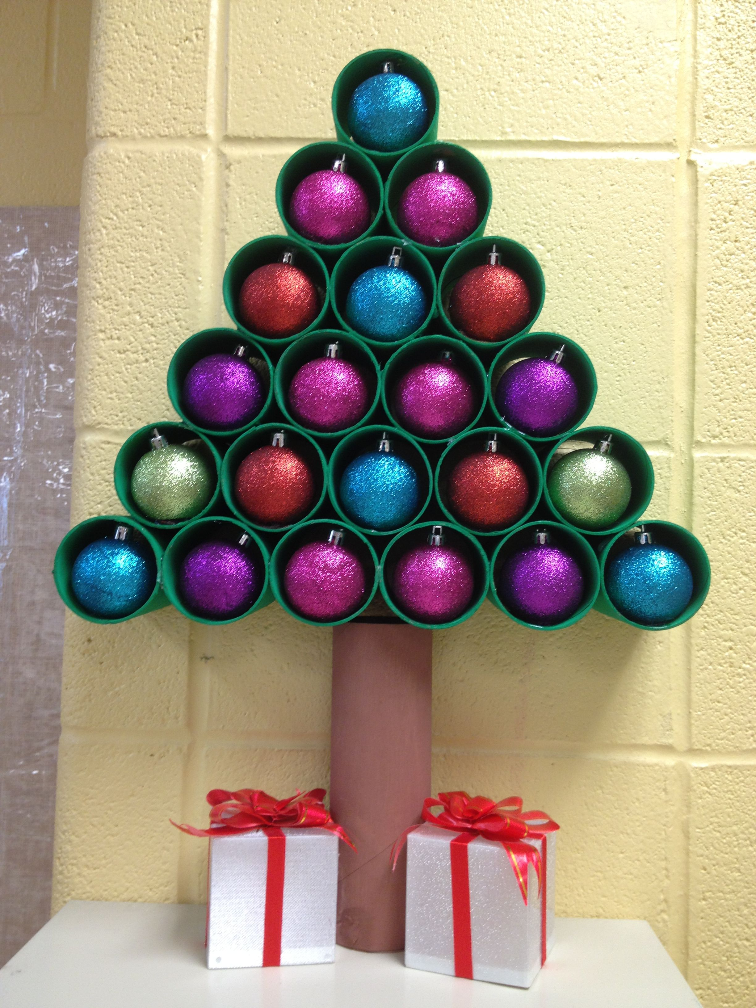 Christmas Tree made with toilet paper rolls, painted with tempera, added  ornaments and gifts