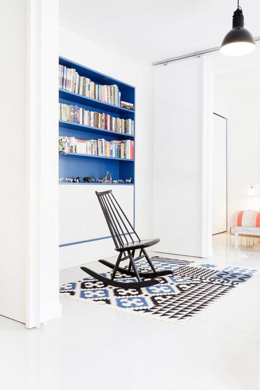 paint built-in shelves a bright colour