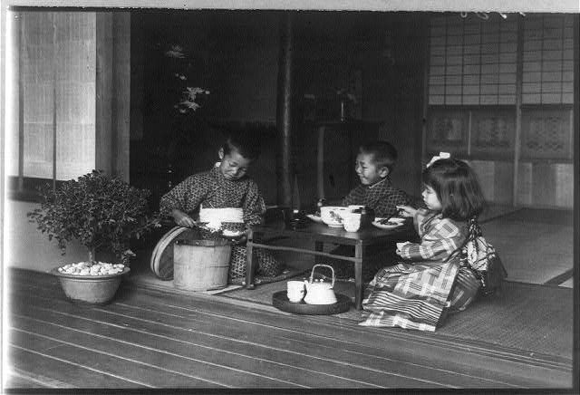 Three children at tea party / Japan - between 1890-1920