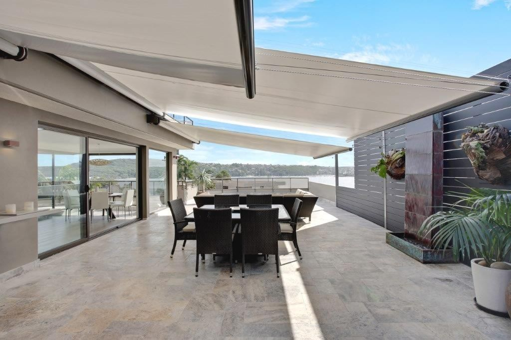 Motorised Rainproof Retracting Awnings Provide Rain And Sun Protection For This Exposed Large Terrace Rustic Pergola Pergola Designs Pergola