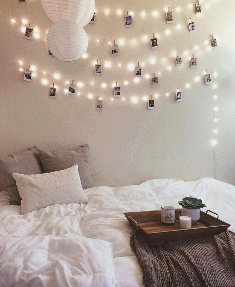 string lights and clothespinned polaroids Find this