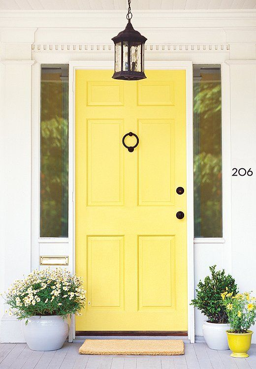 The 8 Hottest Paint Colors Of The Year Yellow Front Doors Front Door Paint Colors Painted Front Doors