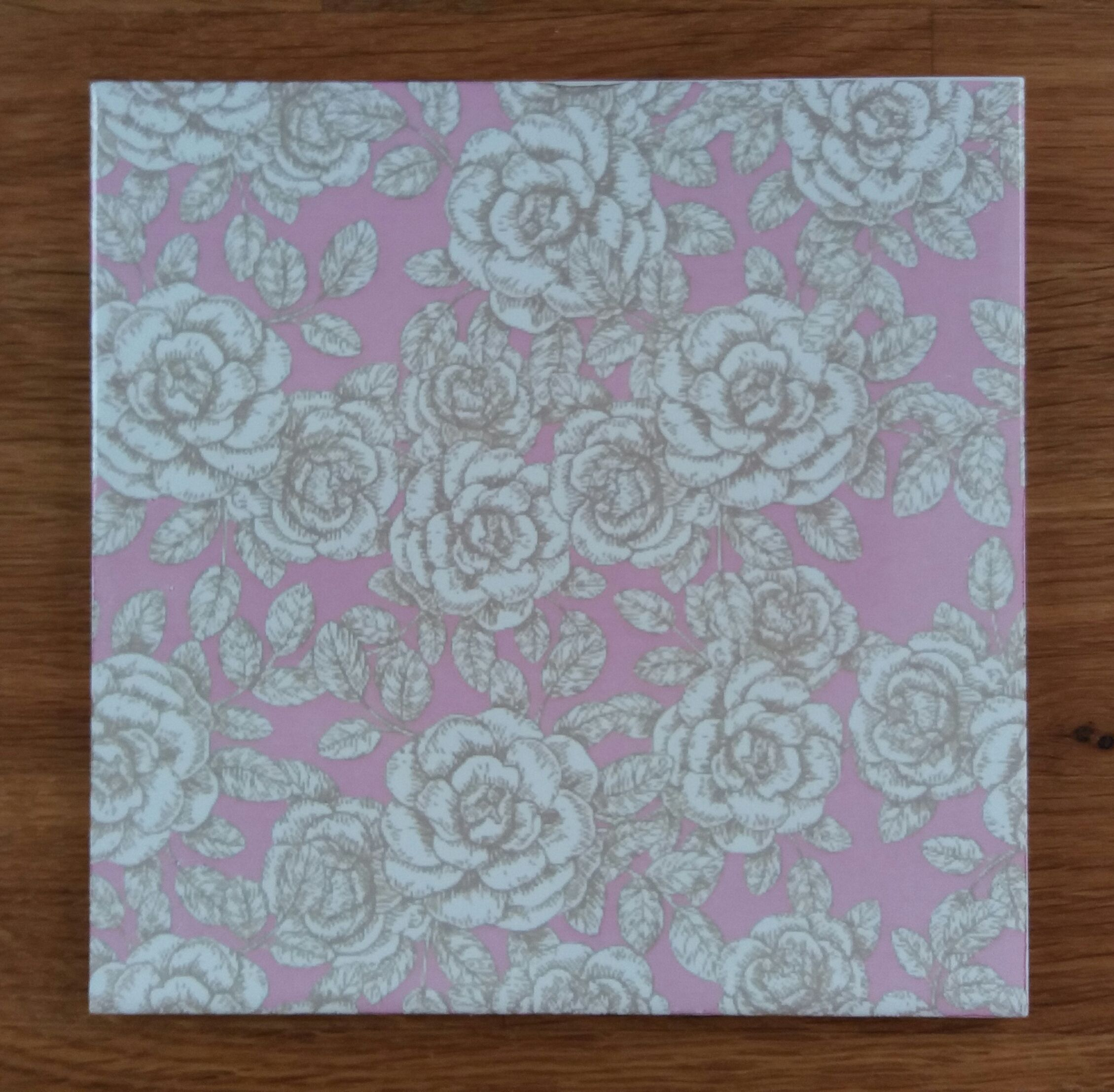 Pink and white floral patterned decorative ceramic wall tile by