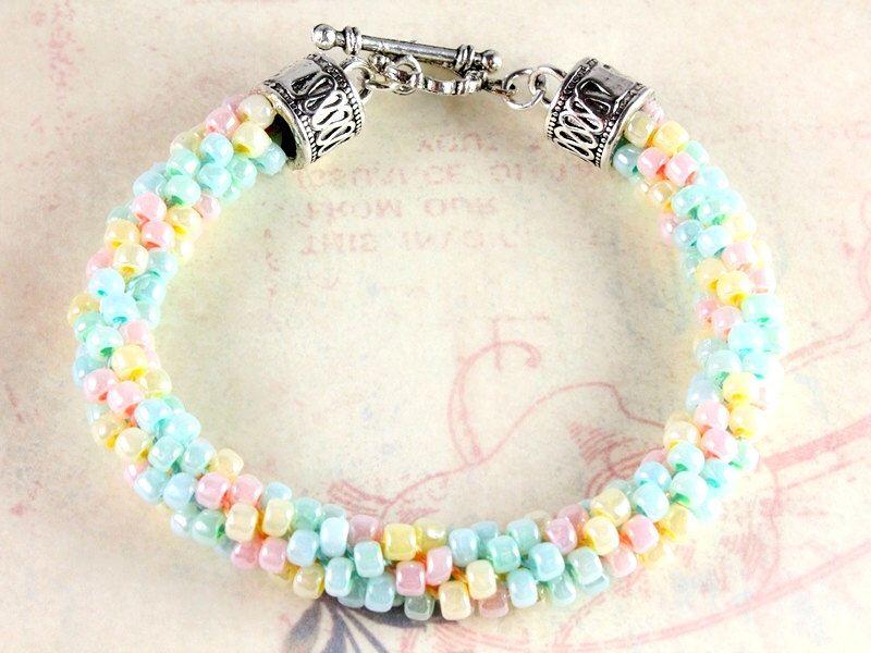 Kumihimo Bracelet - Pastels - Spring Kumihimo by NancysCrystalFantasy on Etsy https://www.etsy.com/listing/182792398/kumihimo-bracelet-pastels-spring