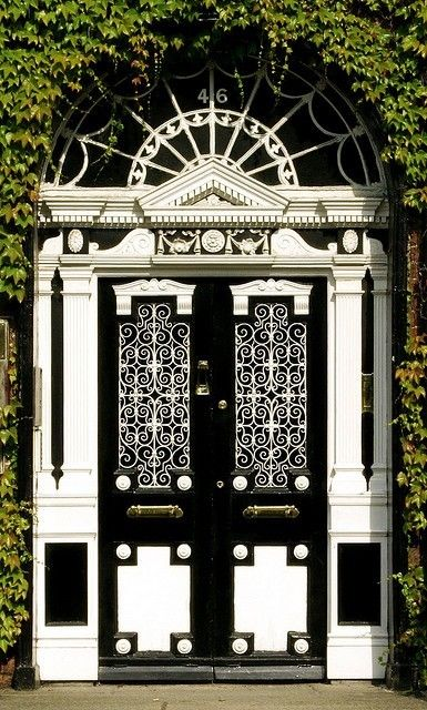 Greenery compliments the beautiful black and white doors