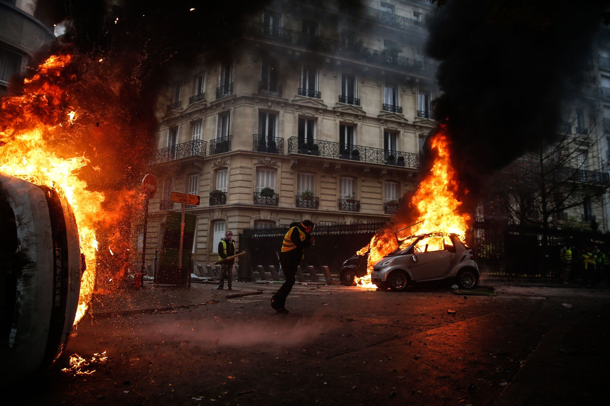 Burning cars from a protest in Paris on Saturday [2048 x