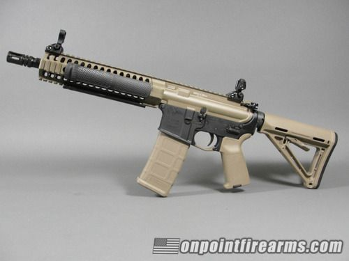 """LWRC M6IC-A5 10"""" upper in FDE Cerakote sitting atop a Colt"""