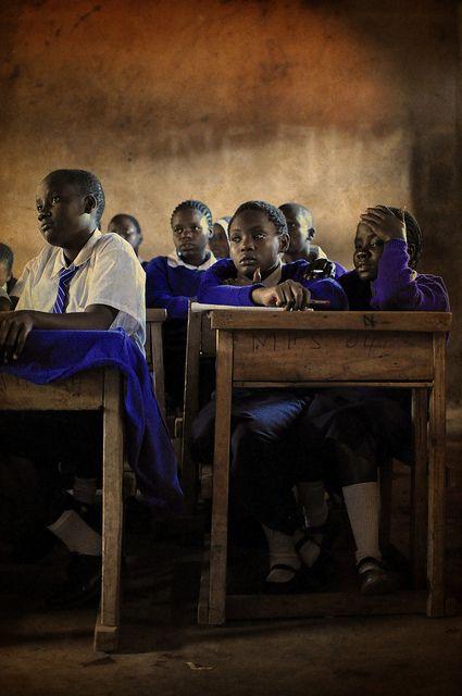 sharing desks - kibera slum, nairobi, kenya