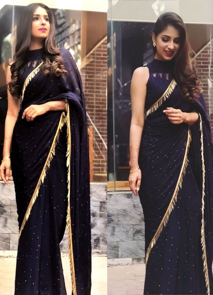 Fancy Black Saree With Gold Frills Full Neck Blouse With Cutout Pattern Black Saree Designs Designer Saree Blouse Patterns Elegant Saree