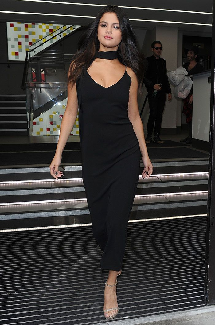 Selena wore this simple black dress from Atea Oceanie with a scarf while out and about in Paris