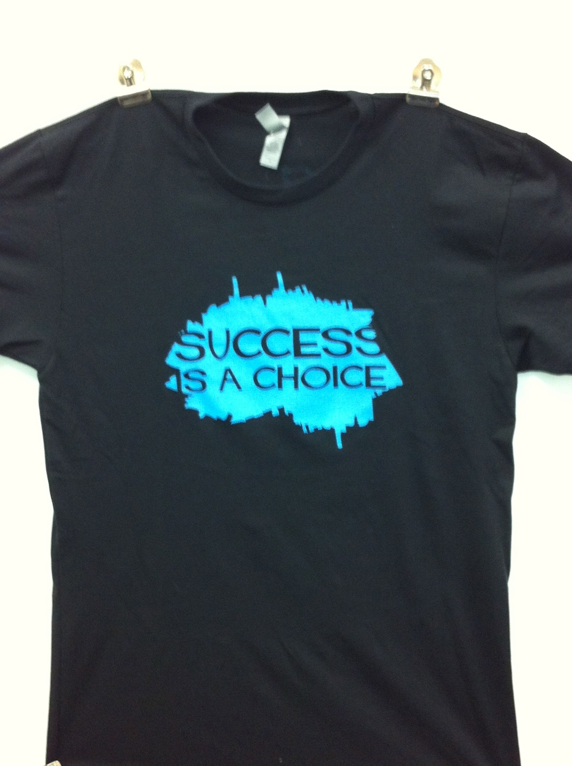 First edition black 60% cotton, 40% polyester. Success is a choice. Site will be ready by friday. :)