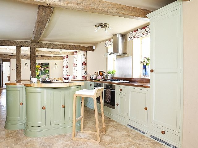 Cottage decor: Kitchen   Parlourfarm  love the colour and the rounded furniture very feminine although I don't like islands  like the lime washed beams