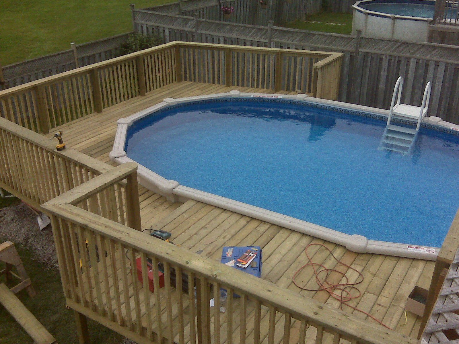 Swimming pool decks patios pinterest backyard for Best material for deck