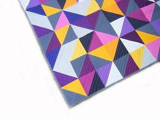Fab color choices in this HST quilt by Nadine Saupeart of This Creative Bliss.