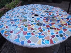 Mosaic Tile Covered Recycled Cable Spool Turned Into A Garden Table