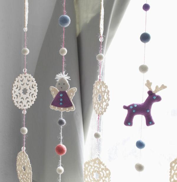 Garlands. 36 cm long. Felt - 100% wool, metal ring, filler - polyester batting. Hand embroidery, hand gathering. Available in different colors.