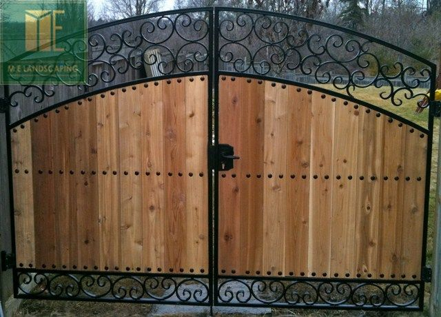 Wood And Iron Gate In Toronto Toronto Landscaping Design Interlock Driveway Paving Company House Gate Design Front Gate Design Door Gate Design