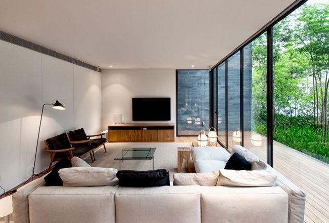 wohnzimmer ecru ecksofa glas schiebetüren terrasse Einrichten - wohnzimmer mit glaswnde