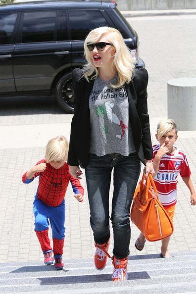 fc8303e87913 Gwen Stefani wearing Puma by MIHARAYASUHIRO My 66 Wedge Sneaker in  Orange White Le Shirt Everyone Loves an Italian Girl Tee in Grey Alexande.