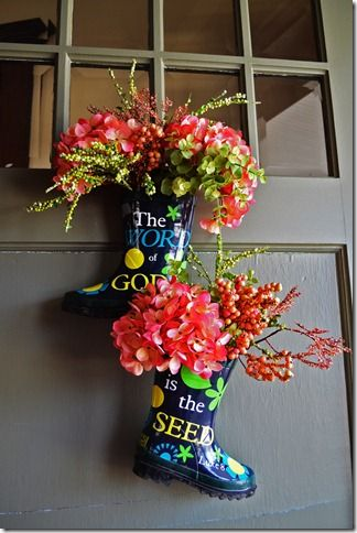 Spring door hanging old boots up cycled with flowers Spring flower arrangements for front door