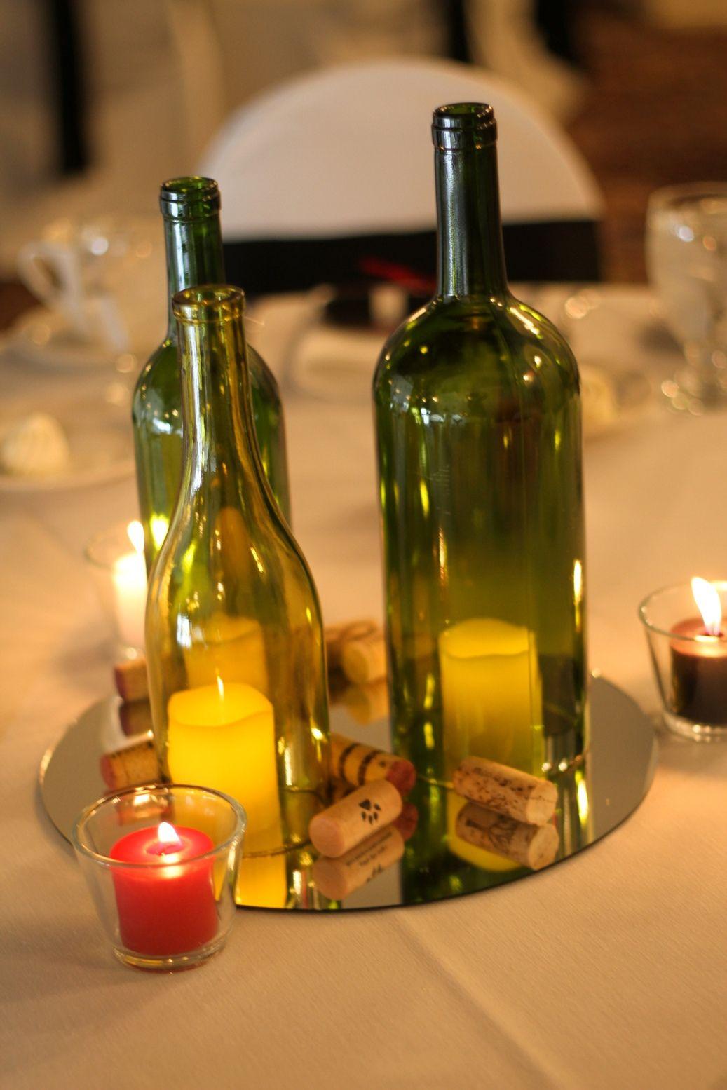 Diy wine bottle centerpiece wine bottle centerpieces for Homemade wine bottle centerpieces