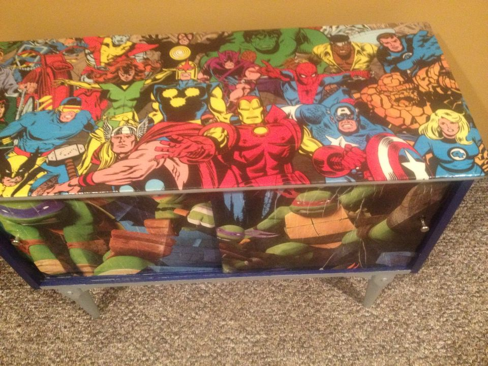 My grandson loves super heroes so I took an old coffee table and modge podge a few posters on the piece of furniture