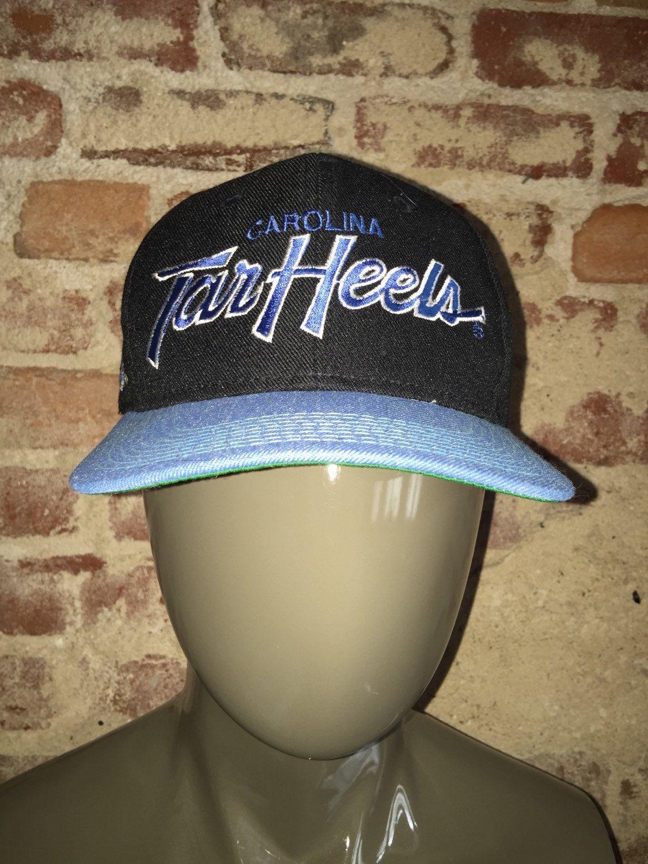 new arrival 98153 3f5c5 Vintage Deadstock 90 s Sports Specialties Wool Script UNC Tarheels NCAA  Snapback Hat Cap by RackRaidersVintage on Etsy