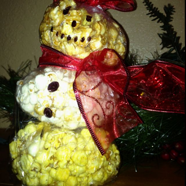 Popcorn Ball Snowman made by Brooke $5.  Please inbox me for orders.  www.facebook.com/brookezaragoza1