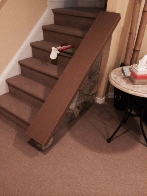 Baby Proof/Child proof your Fireplace with our Fireplace Hearth Guard Pad-a recent after picture of a stair railing with our Guard providing the needed protection for your child
