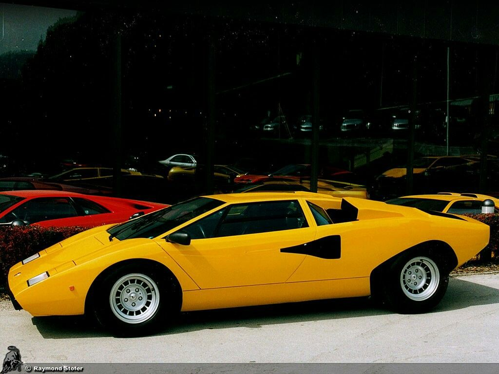 A really nice yellow lamborghini countach over 30 years old and still impressive