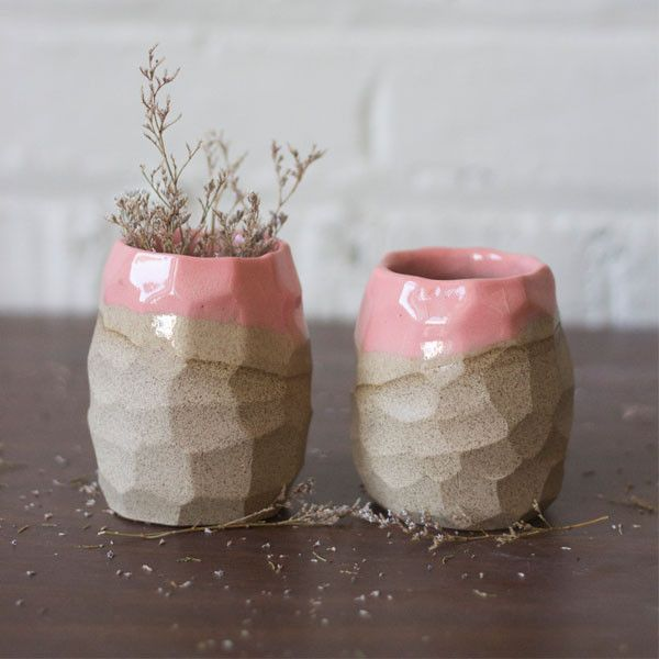 Speckled stoneware is wheel-thrown then faceted into it's unique shape. Dipped in a lovely pink slip and glazed clear, this planter is a perfect pop of color for any home.