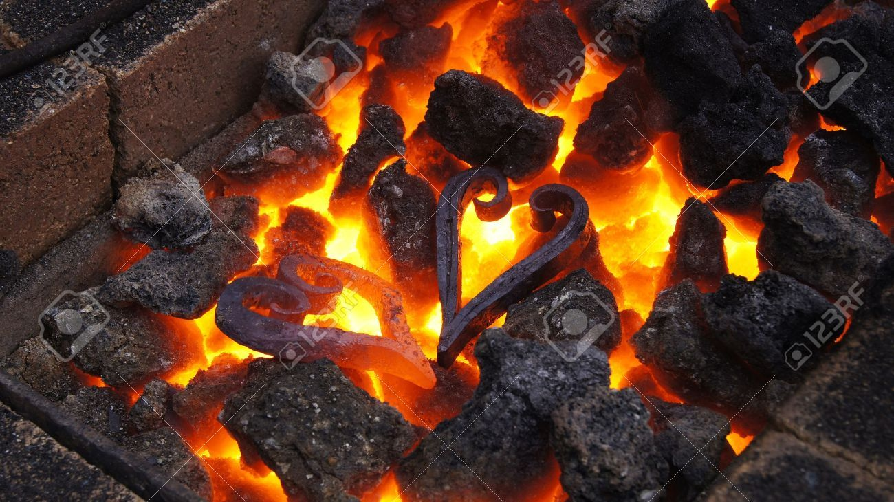 Two Metal Hearts In Hot Fire Stock Photo, Picture And Royalty Free Image. Image 13059392.