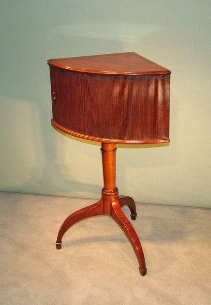"An unusual late 18th Century well-figured mahogany ""Corner"" Tambour Cupboard raised on centre column umbrella-shaped tripod base ending on spade toes. Circa: 1790"