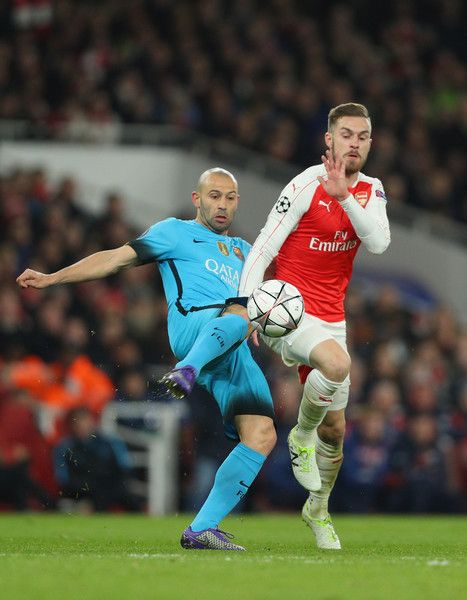 Javier Mascherano of Barcelona makes a tackle on Aaron Ramsey of Arsenal during the UEFA Champions League round of 16 first leg match between Arsenal and Barcelona on February 23, 2016 in London, United Kingdom.