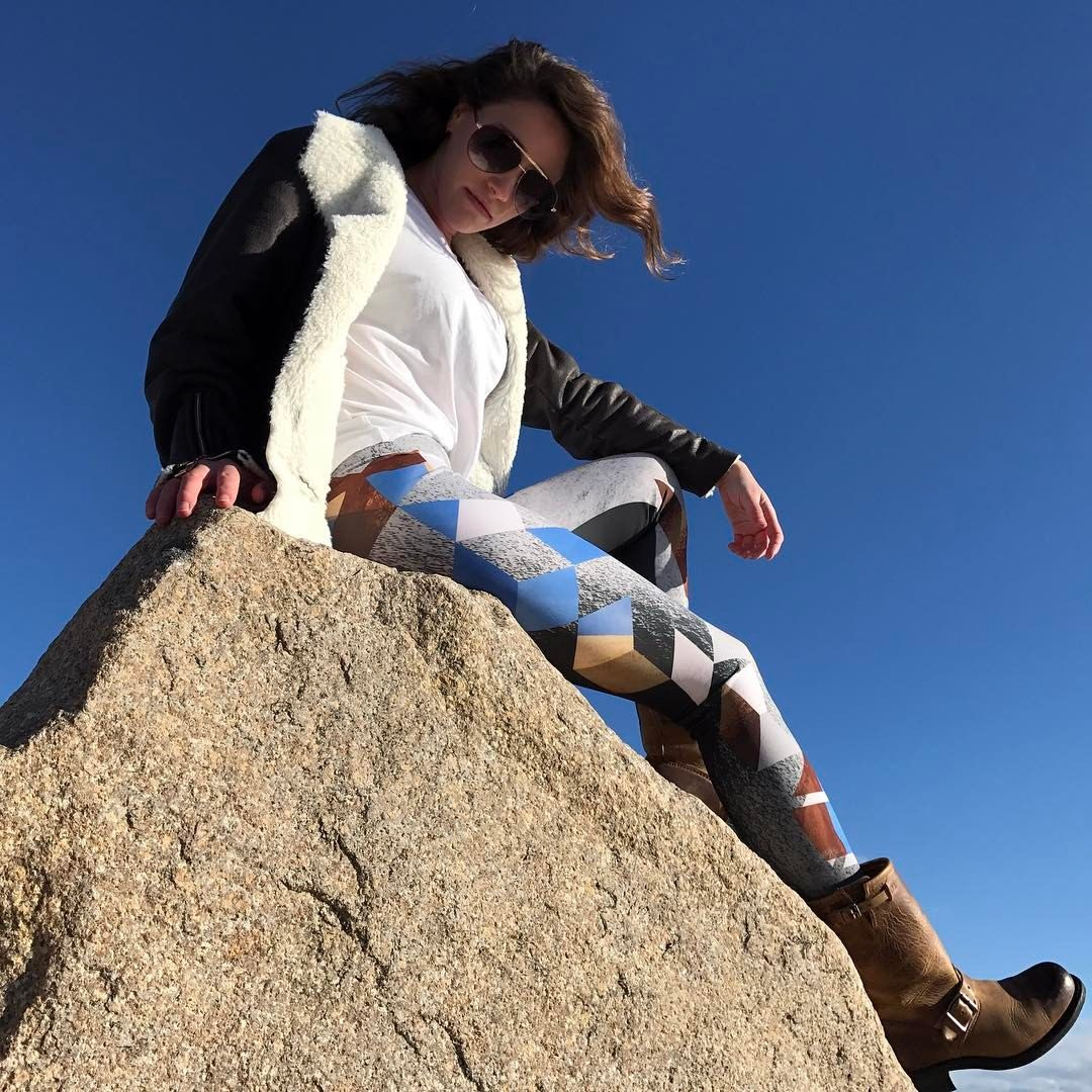 Arch Rock Cubed - Leggings // Axly // A cubist interpretation of Arch Rock found in Joshua Tree National Park. 3D cubes of Cerulean blue and desert earth unfold and cascade down the leg on a granite rock background. Axly leggings are mid-rise and perfect for yoga or street style - athleisure wear at it's best! 82% polyester / 18% spandex. Made in USA. Photo taken at Roque Bluffs Beach in downeast Maine.