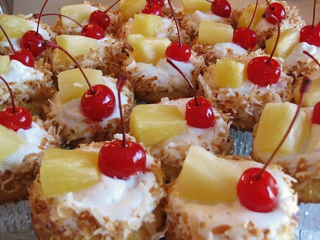 luau cupcakes: replace the water in the vanilla cake mix w/ the pineapple juice. frosted w/ buttercream & added freshly toasted coconut to the edges w/ a piece of pineapple & a cherry