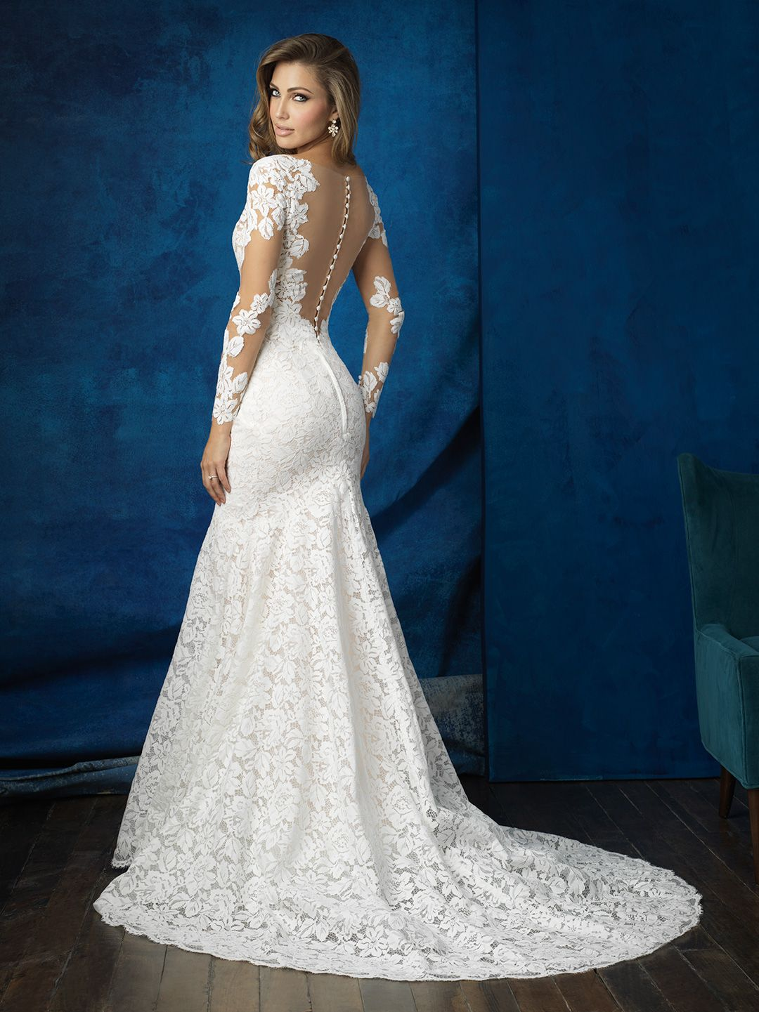 We took a simple lace sheath and added an illusion neckline and