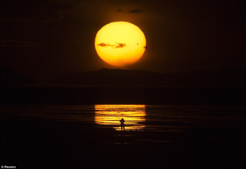 The U.S.: The planet Venus makes a transit as a person watches the sun set over the Great Salt Lake outside Salt Lake City, Utah, June 5, 2012