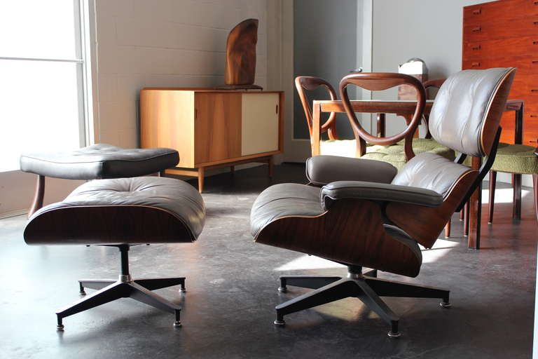 original rosewood and grey leather eames lounge chair and ottoman