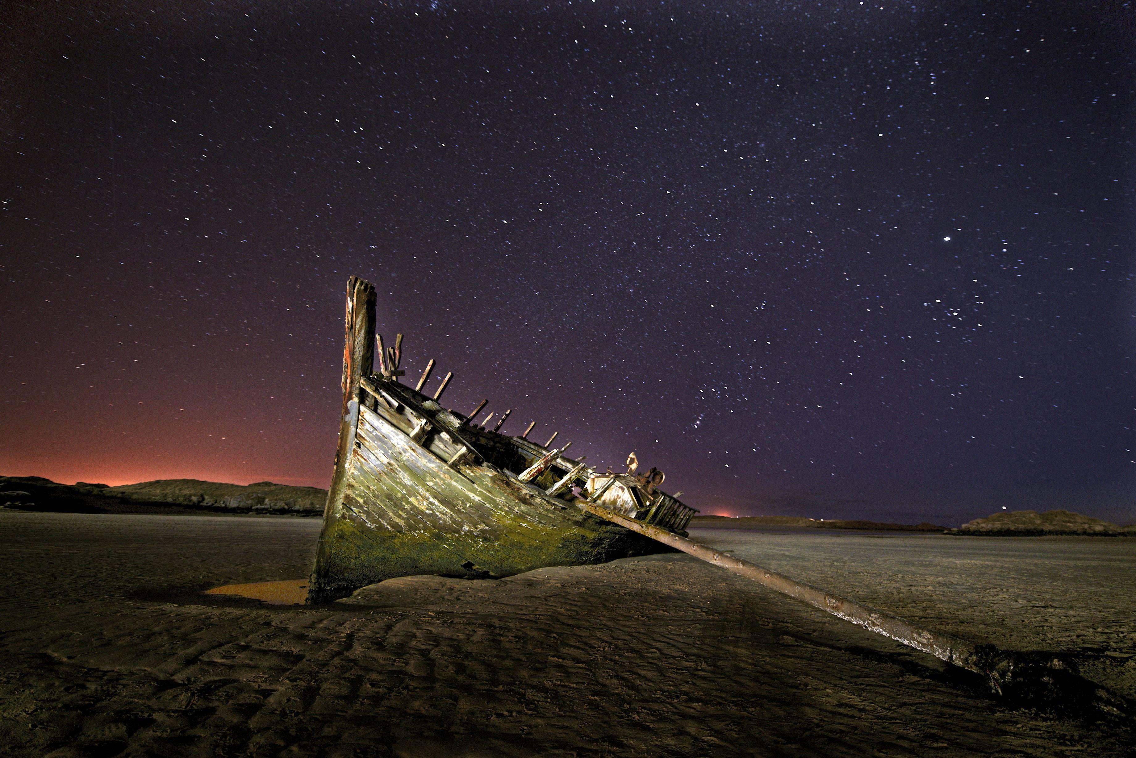 'Bad Eddies' boat wreck at night, Derrybeg, Donegal, Ireland