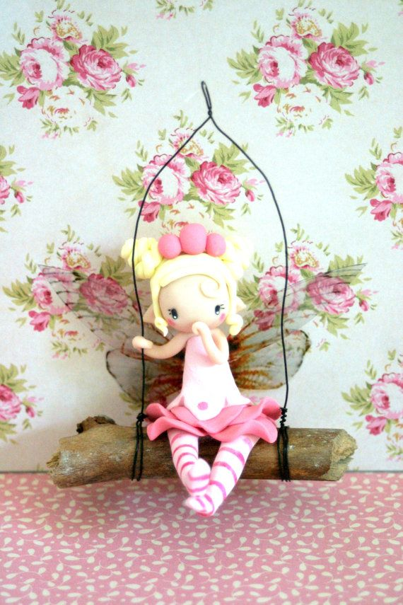 Fairy figurine on swing by TheDollAndThePea on Etsy