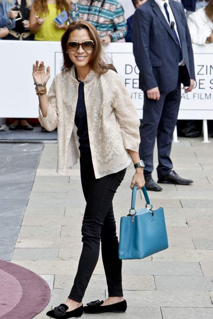 Michelle Yeoh carries a blue Capucines bag from Louis Vuitton s Parnassea  collection b0a78c8aa4fc1