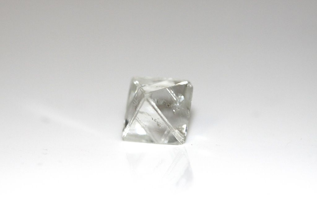 What would you turn this 5.37 carats this clear, colorless octahedron rough diamond into? Ring or pendant? #jewelrydesign #gemstone