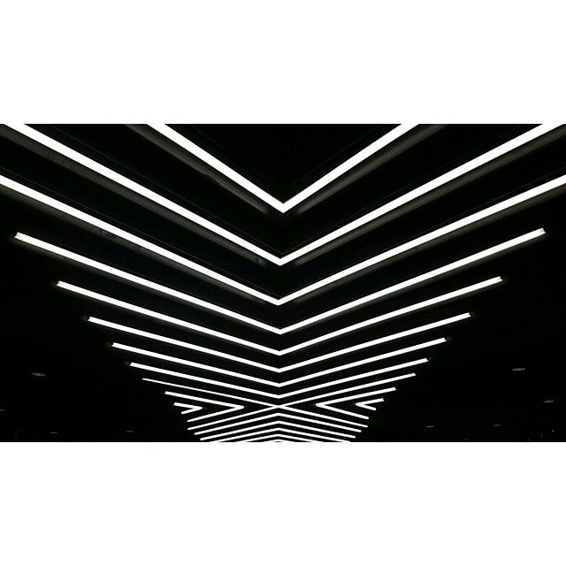 Love these lights #hmkm #niketown #Nike #interior #design #black #white #retail #perspective #symmetry #lines #graphic #lights #London #ukig