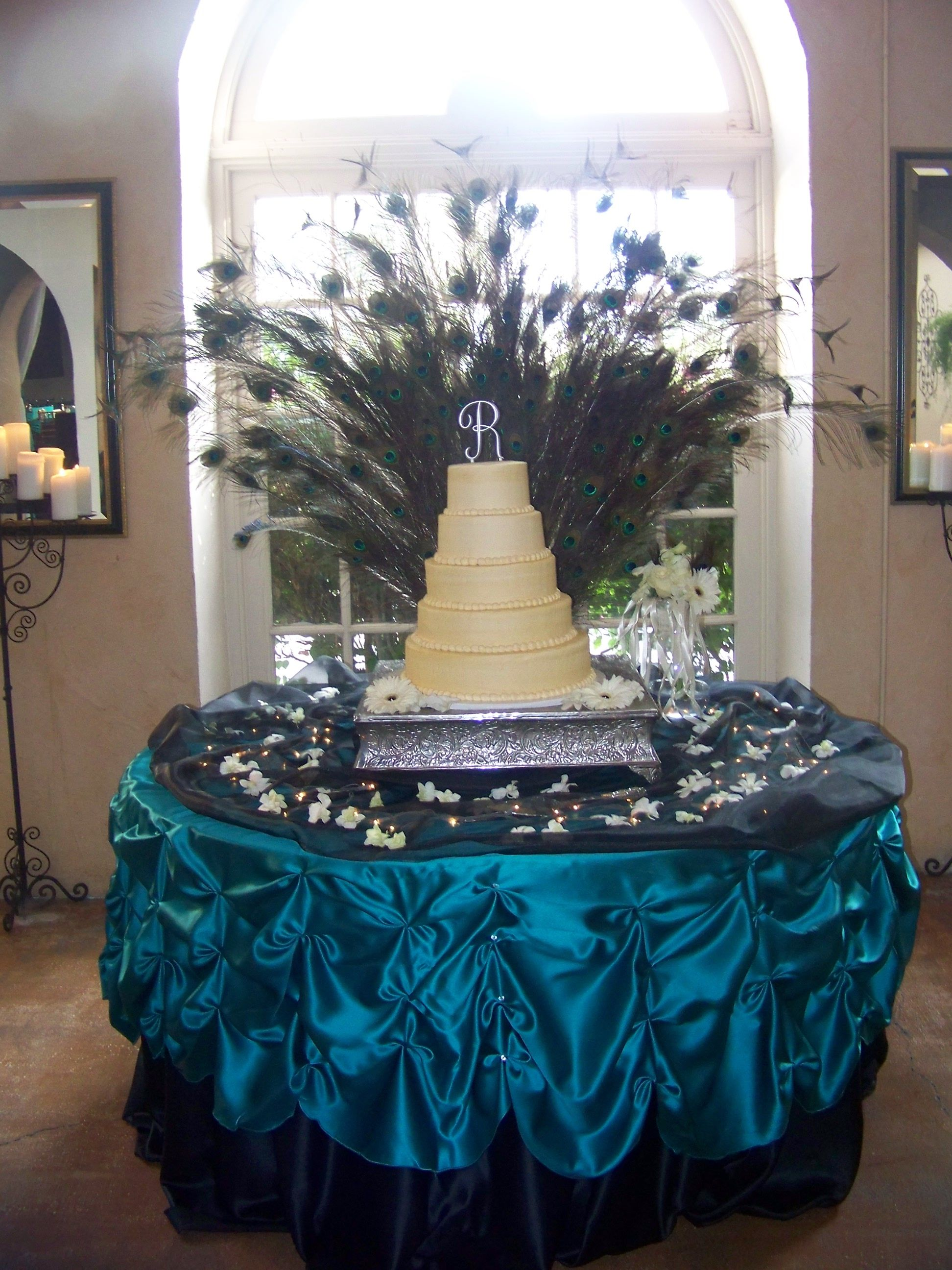 Wedding cake table decoration ideas  Now this is a statement and I love the letter on topPeacock cake