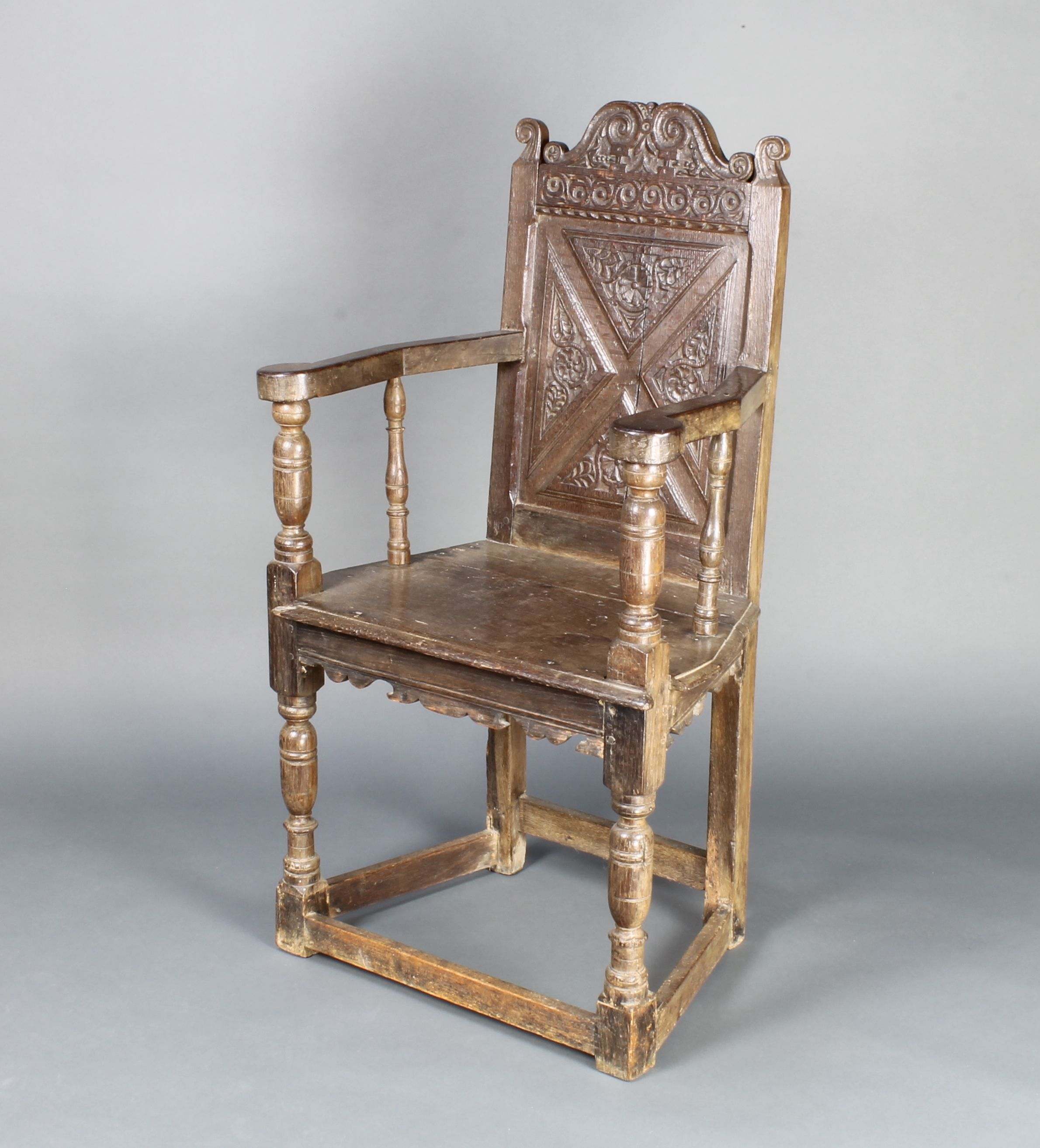 This 17th Century oak Wainscot chair with restoration which