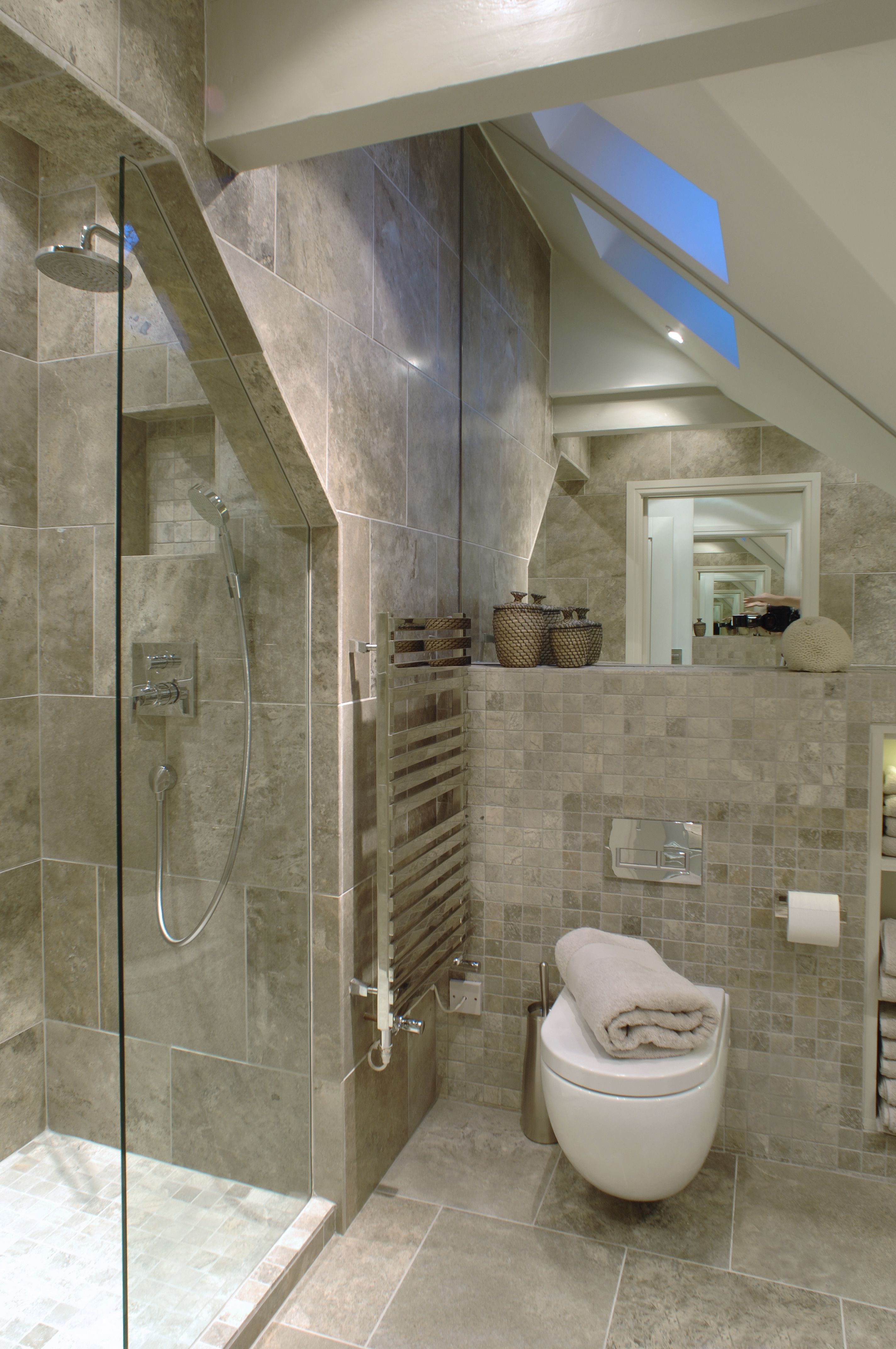 Luxurious shower room in grayscale Narrow seat against far wall