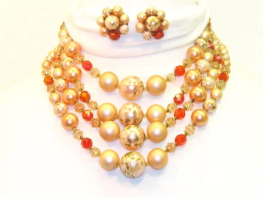 Vintage bib necklace and earring set. True vintage costume jewelry from the 1950's - 1960's era made in Japan. Bright varied orange colors.