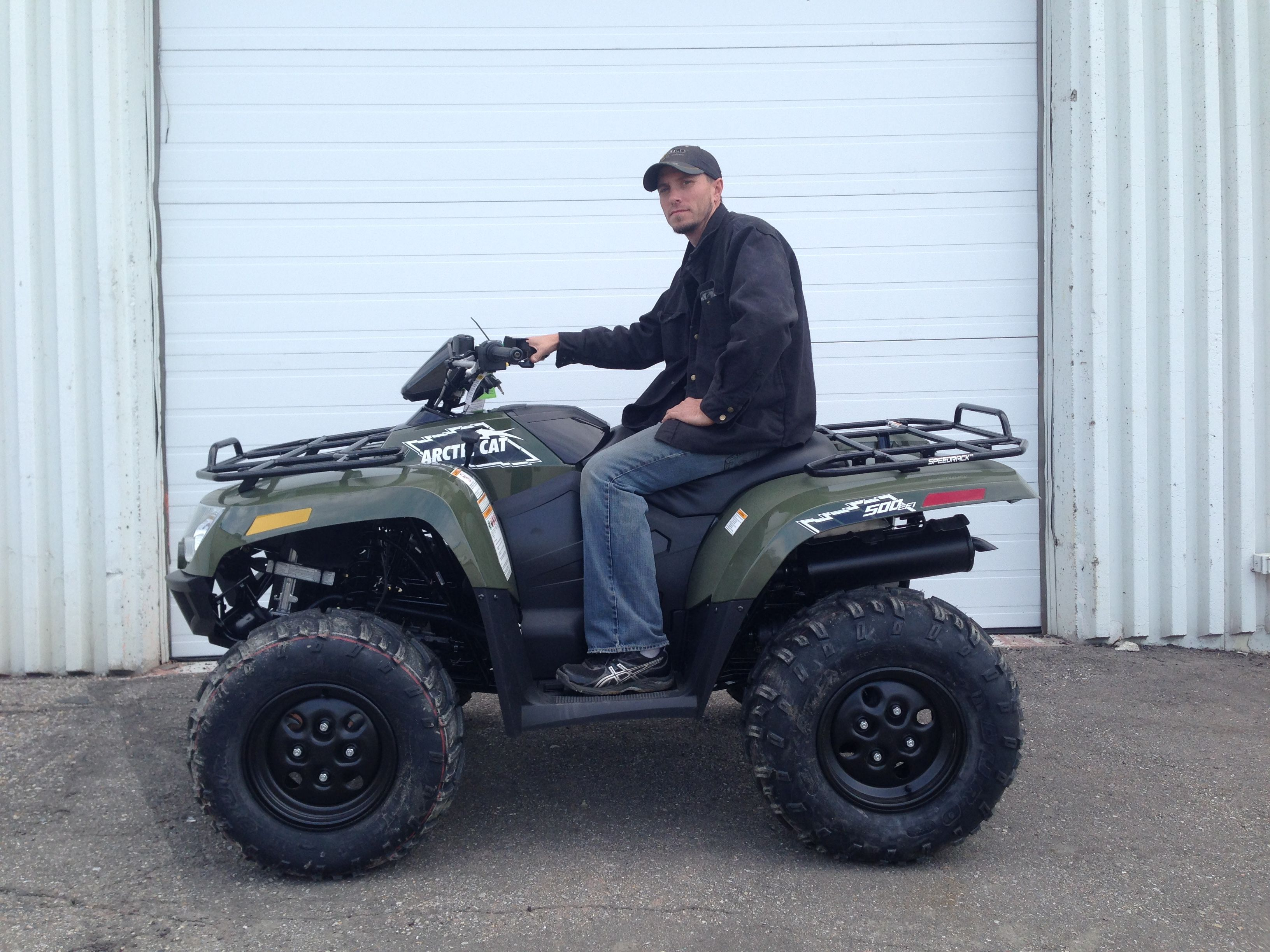 Arthur bring home a 2015 Arctic Cat 500 from Ralph's